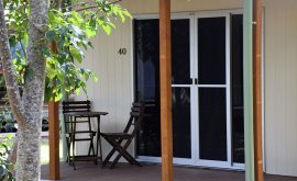Verandah with chairs at Cape York Peninsula Lodge