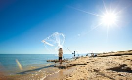 Casting out a net in Karumba