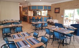Inside the Mulga Country Motor Inn with dining tables set up