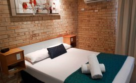 Executive Queen room at Mulga Country Motor Inn with tidy bed and towel