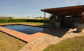 Outdoor pool area surrounded by green grass